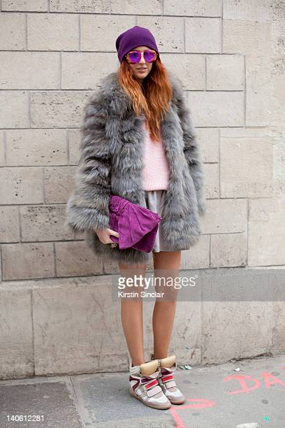 Rea Papathanasiou blogger wearing Isabel Marant trainers Zara skirt Grandmothers sweater Marc jacobs sunglasses Topshop jewellery hat and clutch...