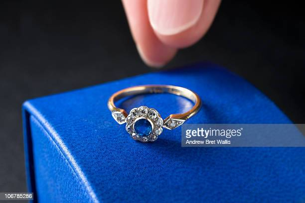 reaching for a sapphire & diamond engagement ring