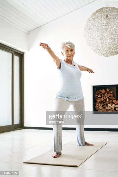 reaching for improved health, one stretch at a time - one senior woman only stock pictures, royalty-free photos & images