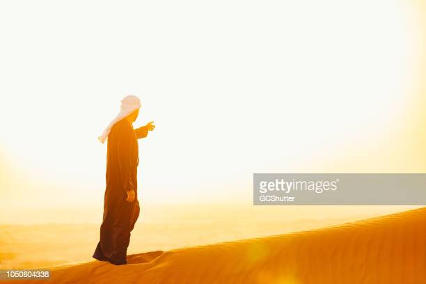 reaching forward in the hope for more - gulf countries stock pictures, royalty-free photos & images