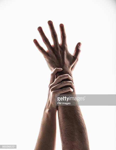 reaching hands - gripping stock pictures, royalty-free photos & images