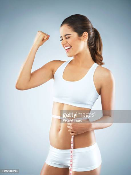 reaching her health goals - waist stock pictures, royalty-free photos & images