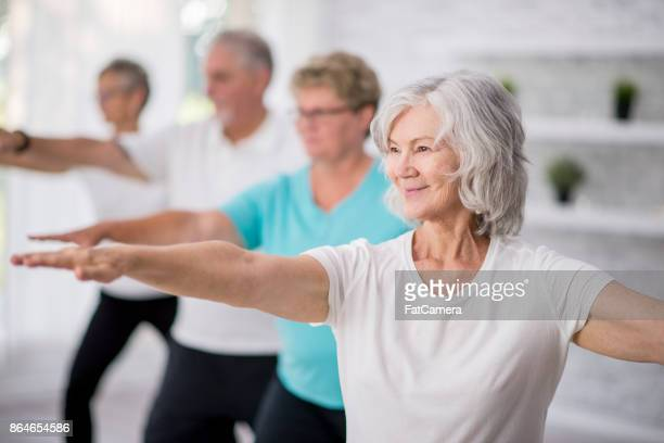 reaching out - active senior woman stock photos and pictures