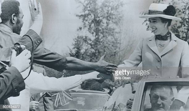 Reaching out to the folks along the route of the royal tour yesterday at Kelowna BC Princess Anne shakes hands with a man standing beside her car An...