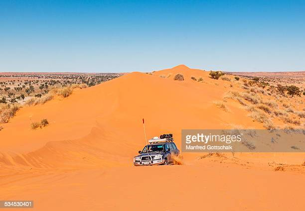 4WD reaching the crest of the 'Big Red'