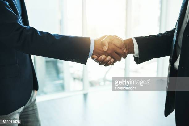 reaching their business goals together - zoom in stock photos and pictures