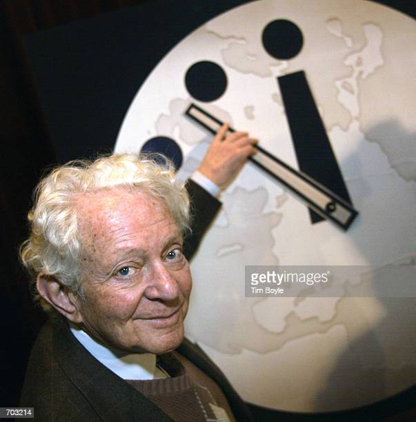 Reaching towards the minute hand Physics Nobel Prize winner Dr Leon M Lederman director of the Fermi National Accelerator Laboratory in Batavia...