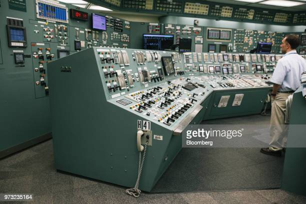 A reactor operator works in the control room at the Exelon Corp Three Mile Island nuclear power plant in Middletown Pennsylvania US on Wednesday...
