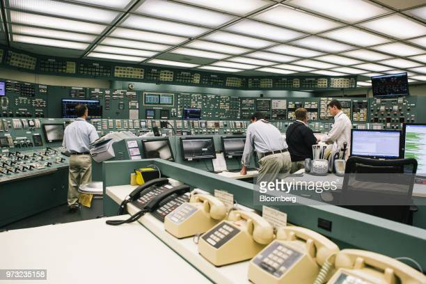 Reactor operators work in the control room at the Exelon Corp Three Mile Island nuclear power plant in Middletown Pennsylvania US on Wednesday April...