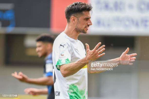 reactsMoenchengladbach's German forward Lars Stindl during the German first division Bundesliga football match SC Paderborn v Borussia...