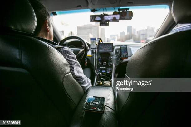 A reader for Tmoney electronic payment service operated by Korea Smart Card Co sits on an armrest inside a taxi in Seoul South Korea on Sunday Jan 28...