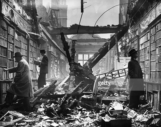 Readers choosing books which are still intact among the charred timbers of the Holland House library London 23rd October 1940