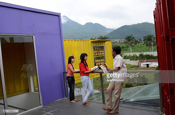 Readers on a balcony of a unique library building 'AMIN' which is constructed out of seven cargo containers and is designed to be a comfortable space...