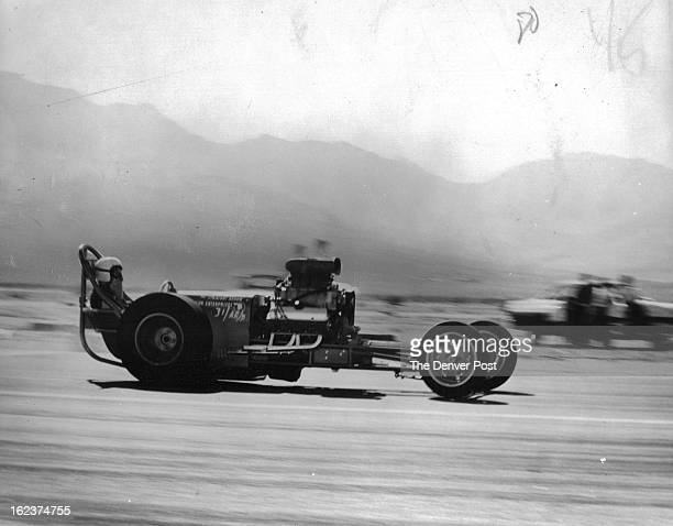 JUL 28 1961 Readies Dragster for CDR Meet Sunday Jim Nelson of Carlsbad Calif is shown making trial run in new Pontiacpowered Dragmaster Straight...