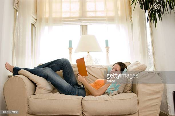 reading a book on the sofa