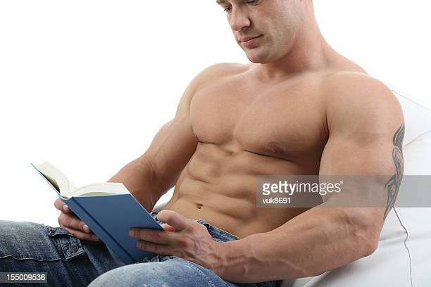 reading a book - sexy male torso stock pictures, royalty-free photos & images