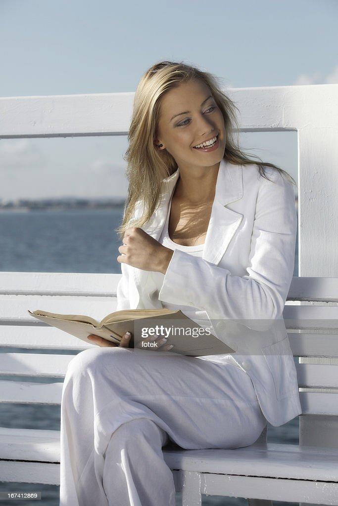 Reading a book : Bildbanksbilder