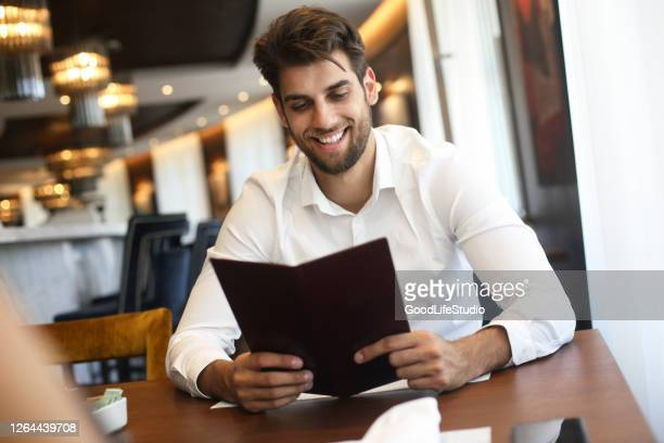 reading a menu - luxury hotel stock pictures, royalty-free photos & images