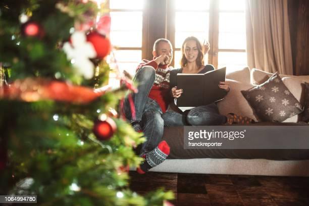 reading novel for christmas sofa