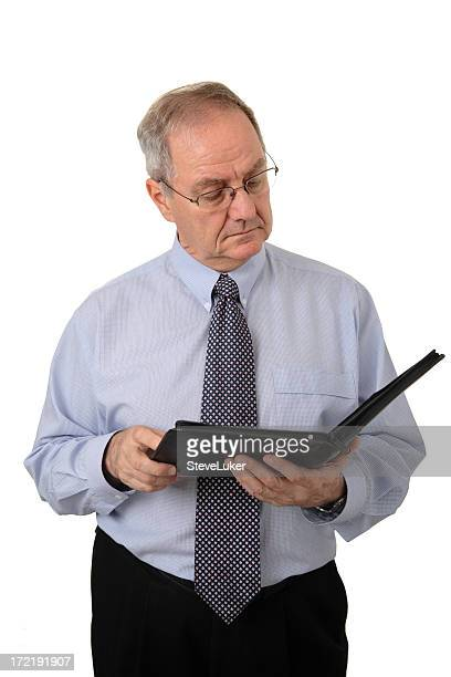 reading a report - handbook stock photos and pictures