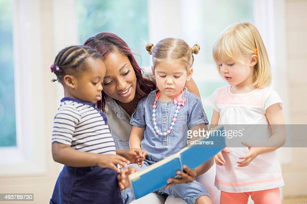 Reading a Story Book to Toddlers