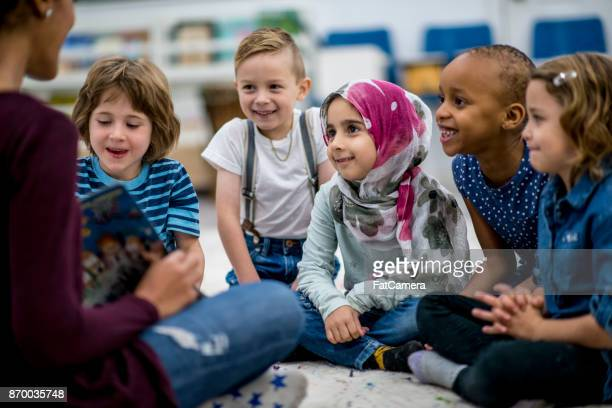 reading a storybook - classroom stock photos and pictures