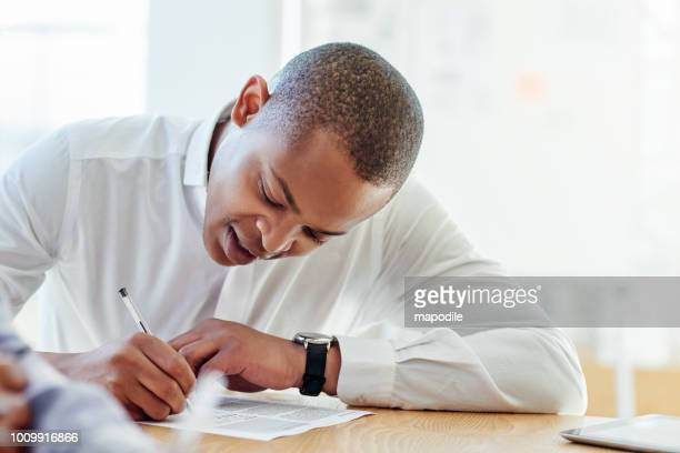 reading all the terms before he signs - form filling stock photos and pictures