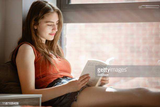 reading and relaxing - literature stock pictures, royalty-free photos & images