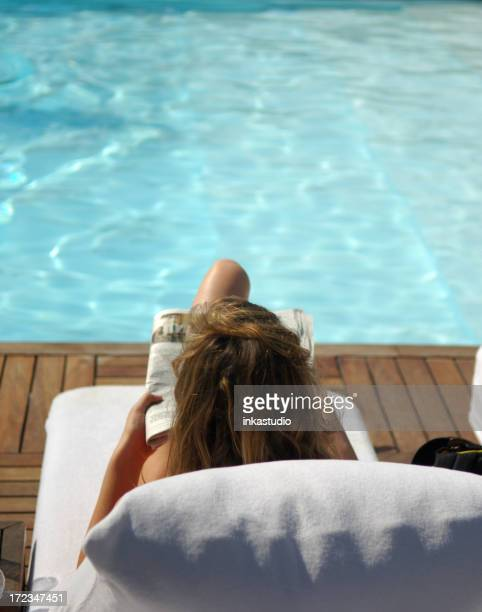 reading at the pool - nature magazine stock pictures, royalty-free photos & images