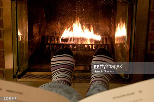 """reading book by fireplace - """"danielle donders"""" stock pictures, royalty-free photos & images"""