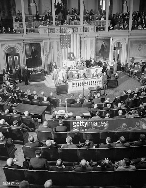 Reading Clerk Irving W Swanson reads the Resolution for War against Germany here on December 11th to an attentive House of Representatives The House...