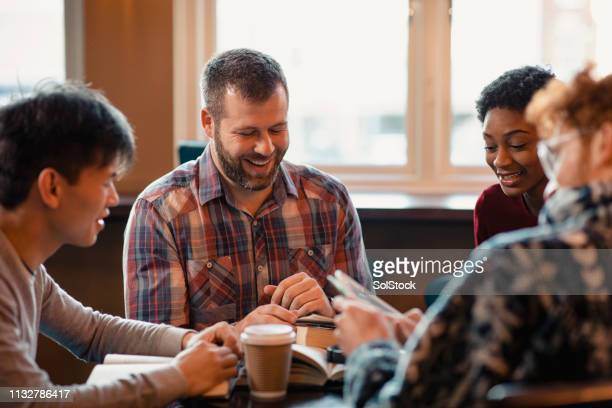 reading during book club - small group of people stock pictures, royalty-free photos & images