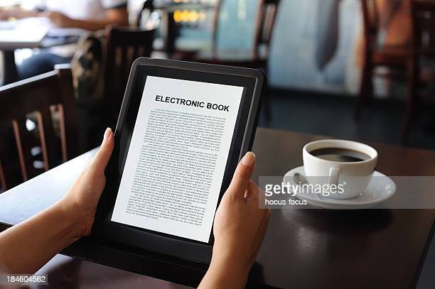 reading E-book on digital tablet