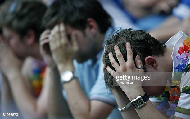 Reading fans show their disappointment as the team are relegated following the Premiership football match against Derby County at Pride Park Stadium...