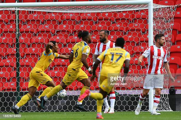 Reading FC celebrate as Liam Moore scores during the Sky Bet Championship match between Stoke City and Reading at Bet365 Stadium on August 07, 2021...