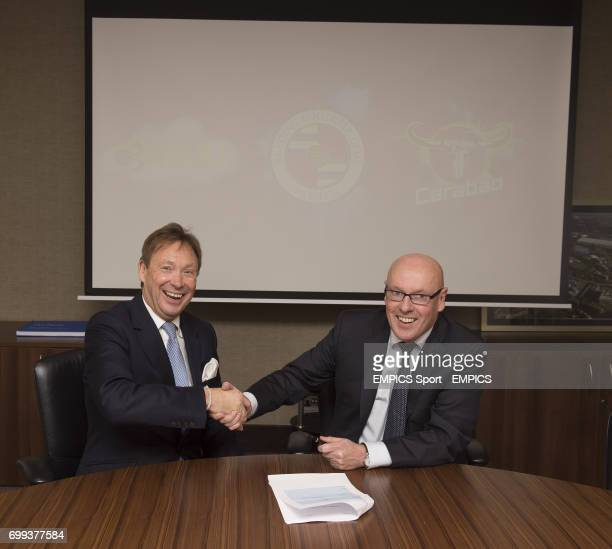 PICTURE*** Reading FC Chief Executive Nigel Howe looks on as new manager Brian McDermott signs his contract prior to a press conference at the...