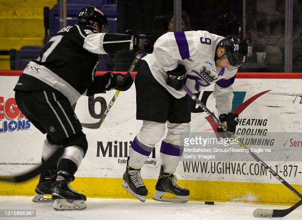 Reading forward Ryan Penny collects a puck in front of Manchester defenseman Craig Wyszomirski .Reading Royals lose 4-2 to the Manchester Monarchs in...