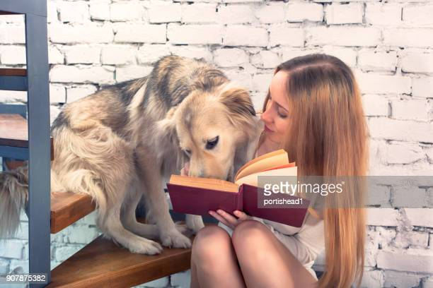 Reading girl and cute dog