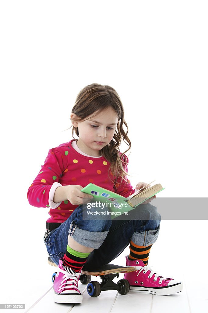 Reading girl : Stock Photo