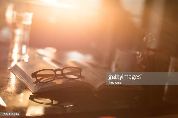 Reading glasses with book on kichten worktop
