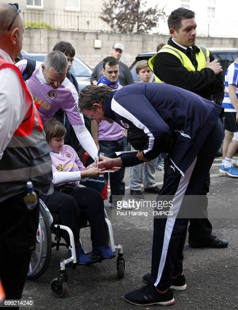 Reading goalkeeper coach Dave Beasant signs autographs