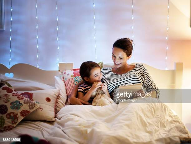 reading her a bedtime story - fairytale stock pictures, royalty-free photos & images