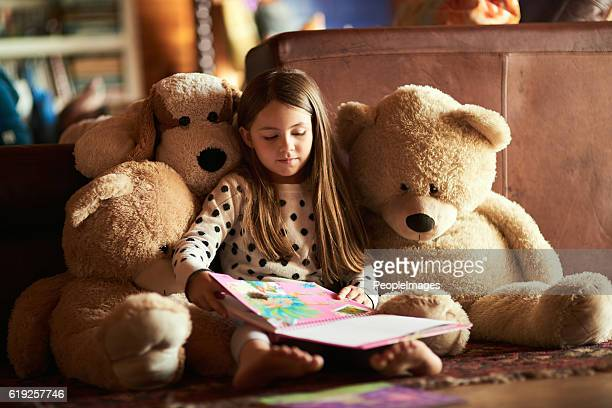 Reading her teddies a story