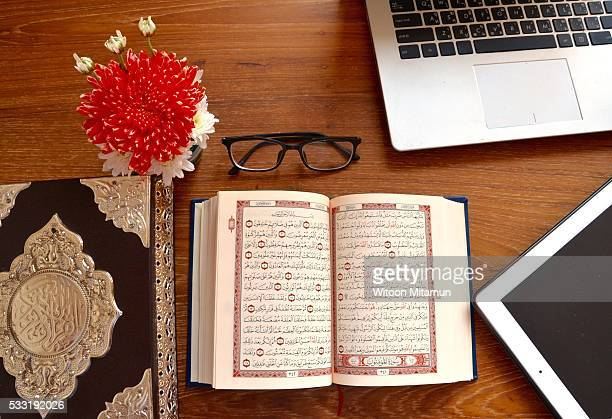 reading holy quran(islamic book) in ramadan night. - namaz stock pictures, royalty-free photos & images