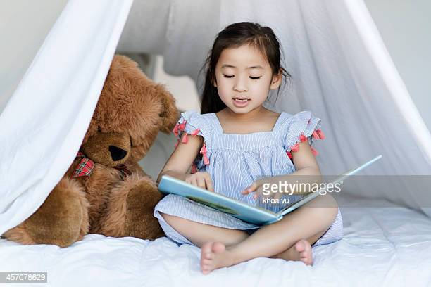 Reading in my white tent