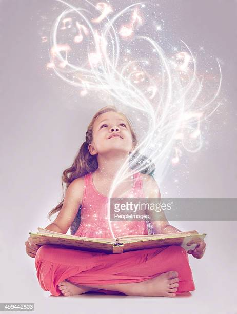 reading is the key to a whole other world - musical note stock photos and pictures