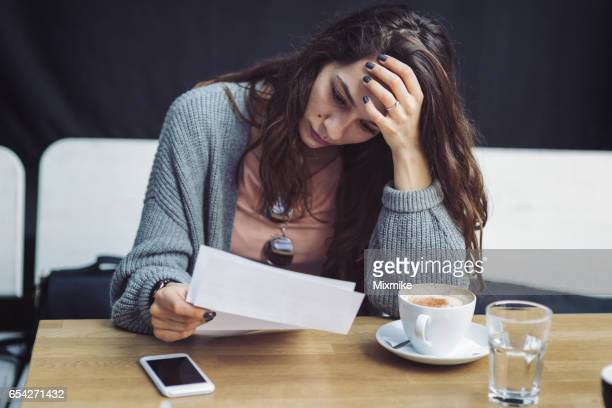 Reading letter in café