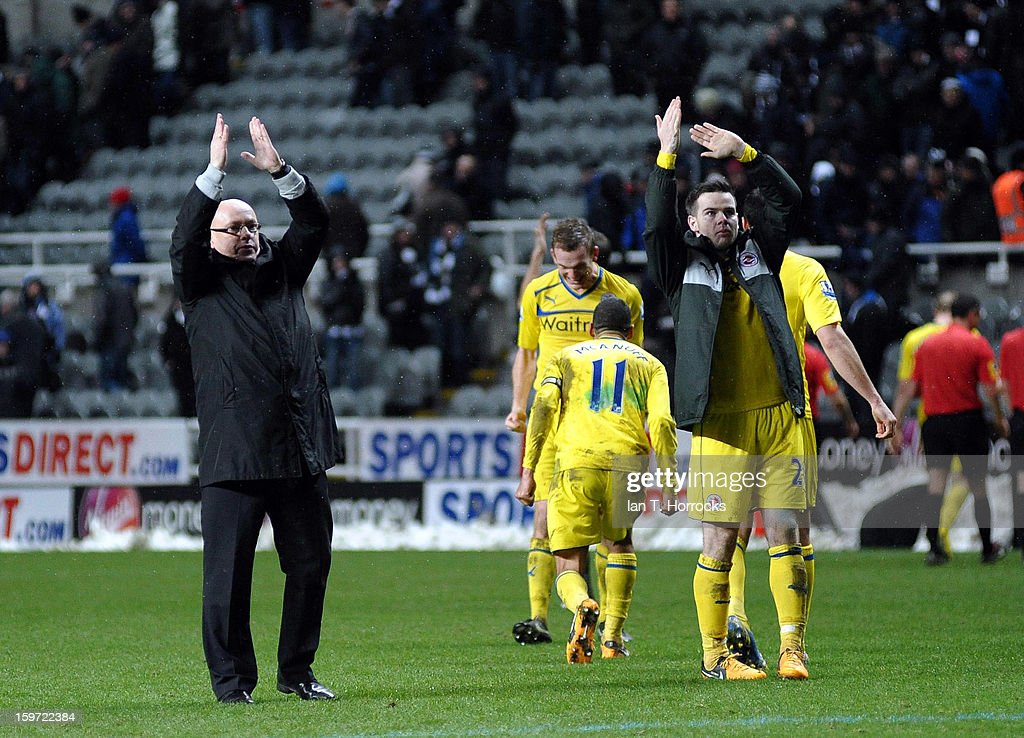 Reading manager Brian McDermott celebrates their victory with his players, including Danny Guthrie (R) after the Barclays Premier League match between Newcastle United and Reading at St James' Park on January 19, 2013 in Newcastle upon Tyne, England.