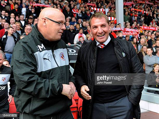 Reading manager Brian McDermott shakes hands with Liverpool manager Brendan Rodgers during the Barclays Premier League match between Liverpool and...