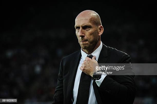 Reading Manager Jaap Stam plays with his tie during the Sky Bet Championship match between Newcastle United and Reading at StJames' Park on August 17...